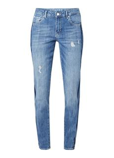 Masha mid rise slim fit jeans met ripped details