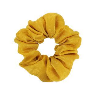 Gele scrunchie glimmend